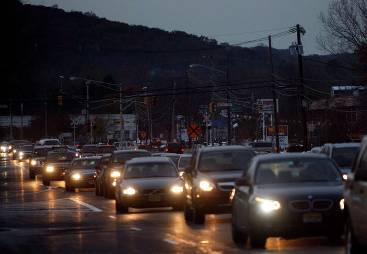 Motorists make their way along Route 10 in Roxbury, N.J. Monday Oct. 31, 2011. An unusual October snow storm this past Saturday dumped up to 15 inches of snow in some areas of N.J. causing power outages across the state. (AP Photo/Rich Schultz)