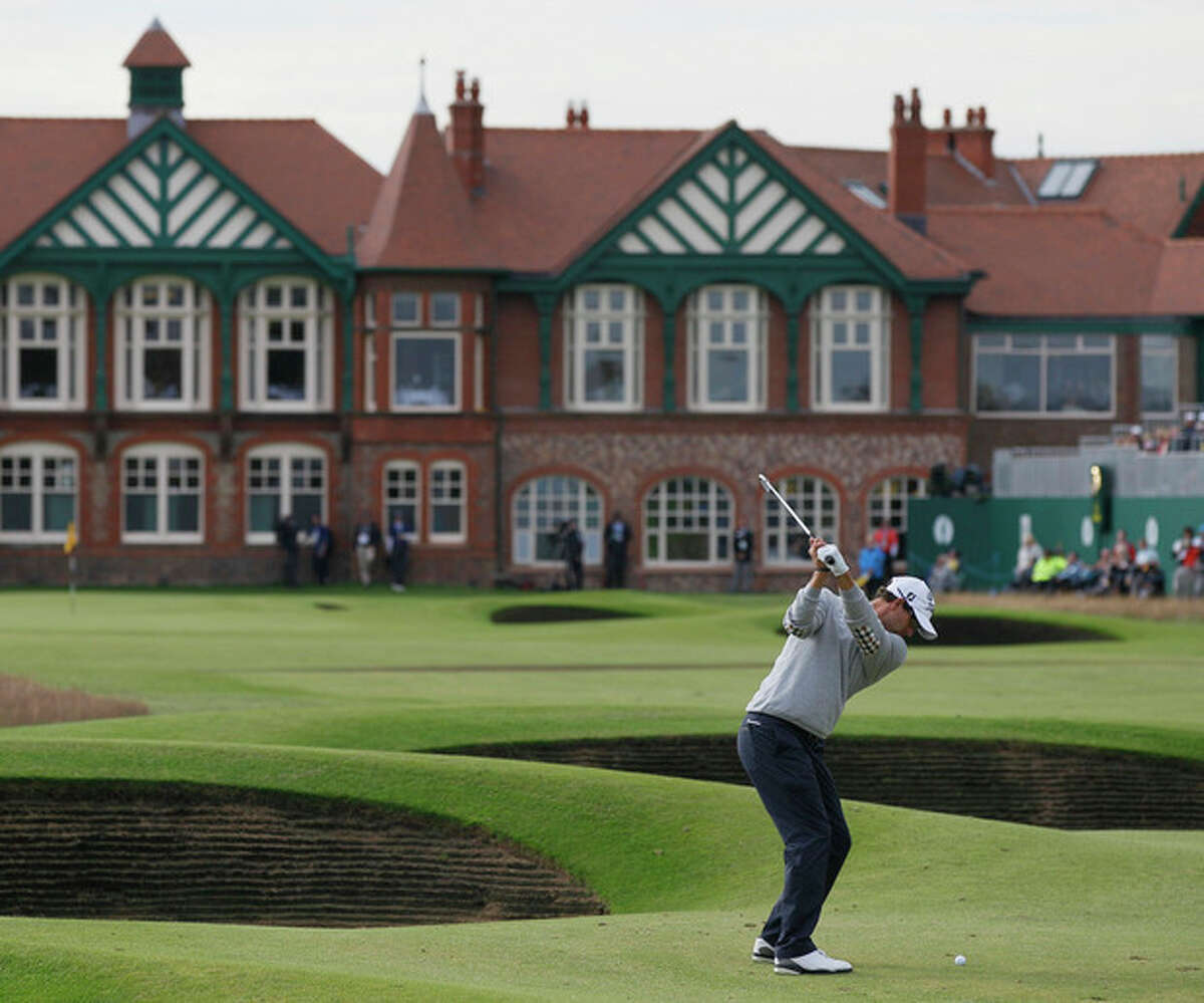 Adam Scott of Australia plays to the 18th green at Royal Lytham & St Annes golf club during the second round of the British Open Golf Championship, Lytham St Annes, England, Friday, July 20, 2012. (AP Photo/Tim Hales)
