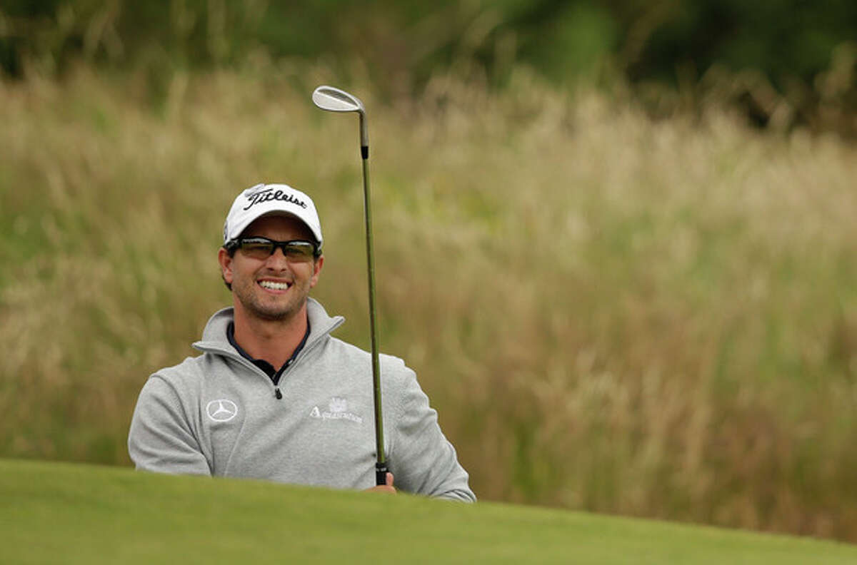 Adam Scott of Australia watches a shot out of a bunker on the 12th hole at Royal Lytham & St Annes golf club during the second round of the British Open Golf Championship, Lytham St Annes, England, Friday, July 20, 2012. (AP Photo/Tim Hales)