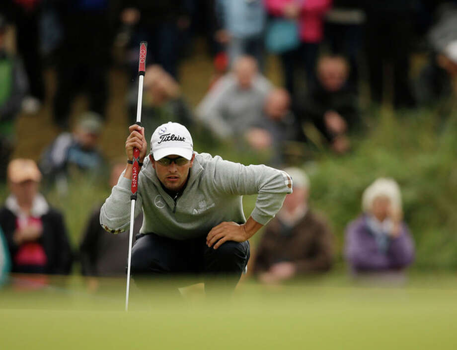 Adam Scott of Australia lines up a putt on the sixth green at Royal Lytham & St Annes golf club during the second round of the British Open Golf Championship, Lytham St Annes, England, Friday, July 20, 2012. (AP Photo/Tim Hales) / AP