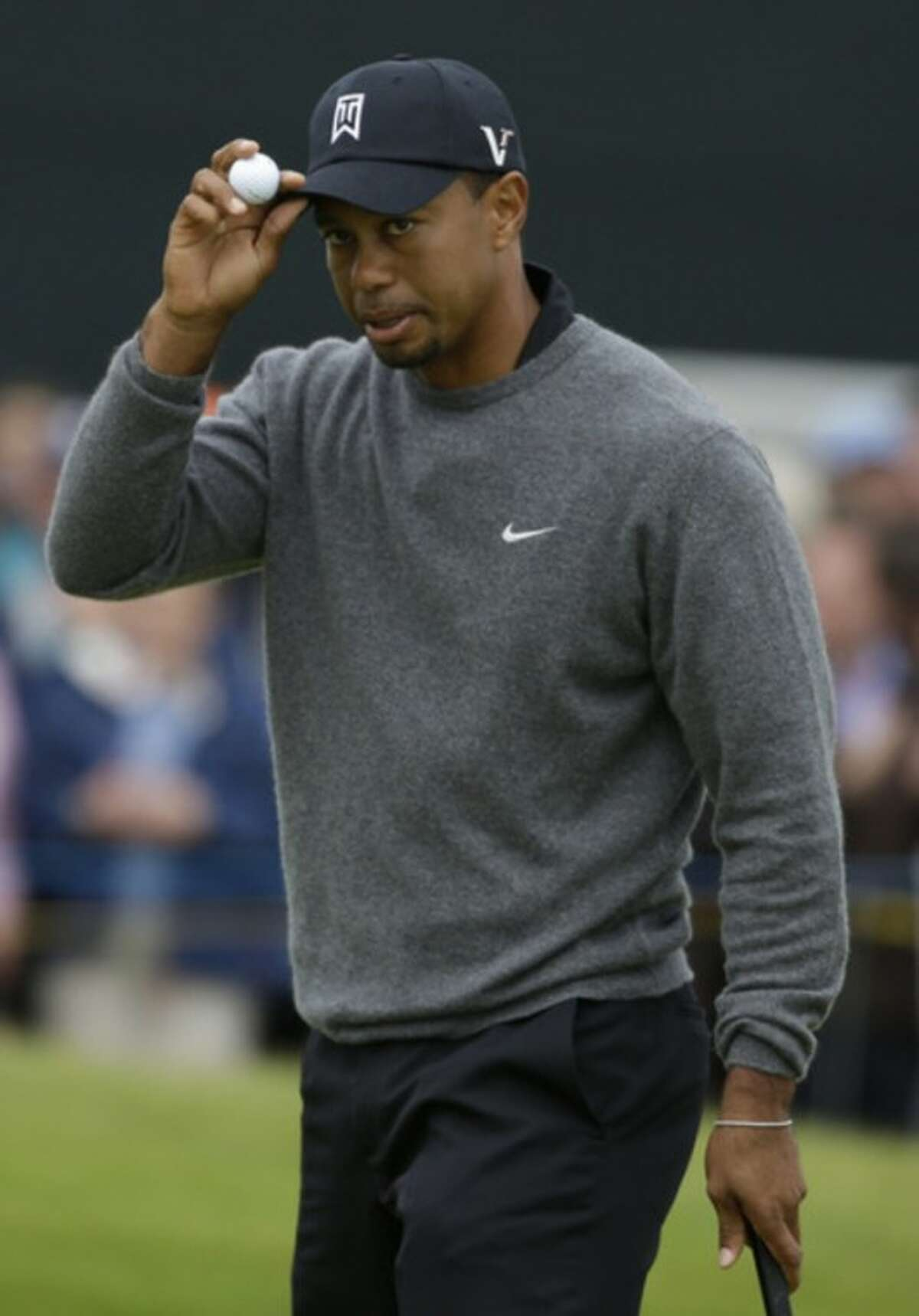 Tiger Woods of the United States reacts after a birdie on the sixth hole at Royal Lytham & St Annes golf club during the second round of the British Open Golf Championship, Lytham St Annes, England, Friday, July 20, 2012. (AP Photo/Chris Carlson)
