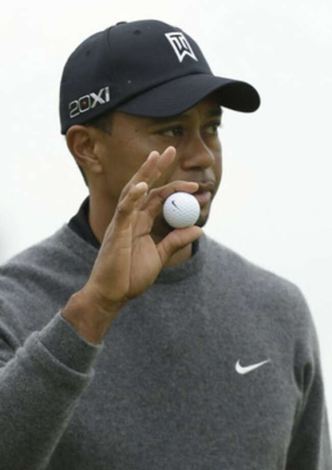 Tiger Woods of the United States gestures after putting on the fourth green at Royal Lytham & St Annes golf club during the second round of the British Open Golf Championship, Lytham St Annes, England, Friday, July 20, 2012. (AP Photo/Jon Super)