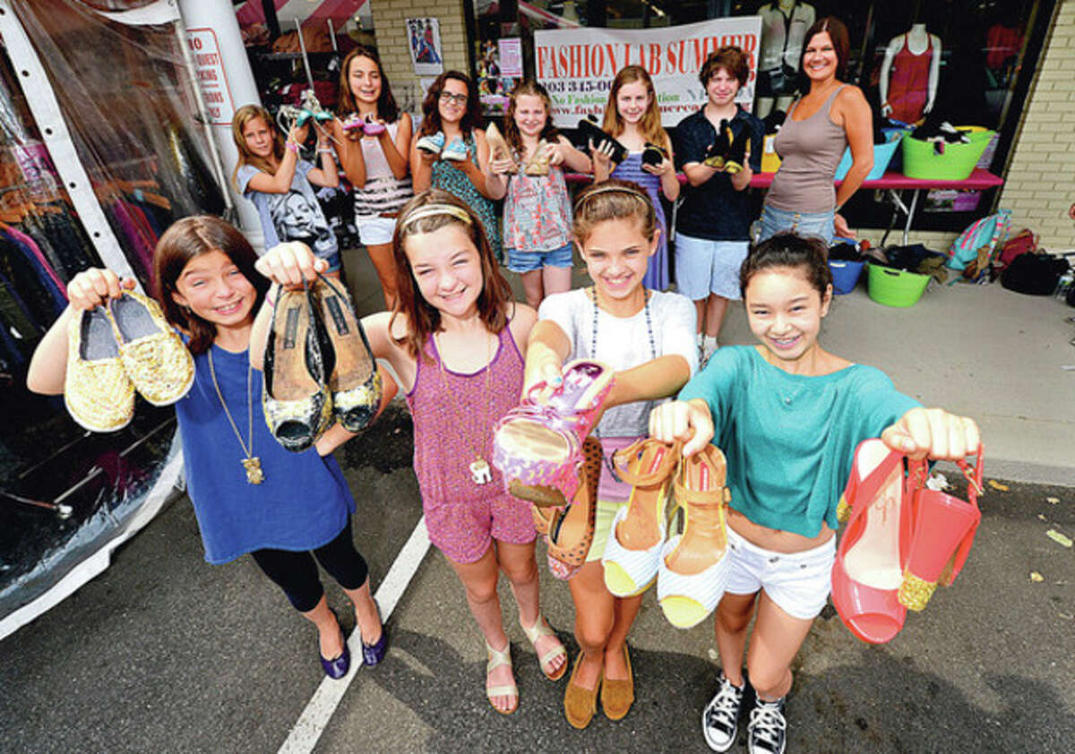 Hour photo / Erik Trautmann Young Fashionistas that attend the New England Fashion Design Association are making Fashion History with a Pop-Up trunk show at Wishlist in Westport for the shoes they created during their summer program.