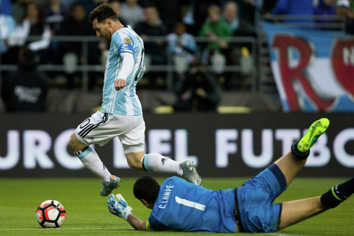 Argentina's Lionel Messi hops over Bolivia goal keeper Carlos Lampe's hands in an attempt on goal during the second half of a Copa America Centenario game at CenturyLink Field, Tuesday, June 14, 2016. Argentina beat Bolivia 3-0.