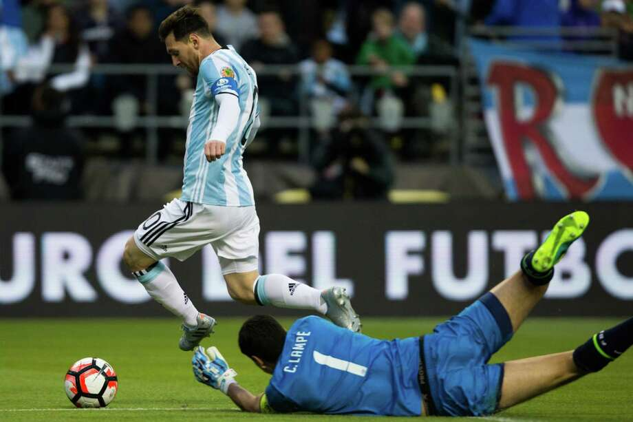 Argentina's Lionel Messi hops over Bolivia goal keeper Carlos Lampe's hands in an attempt on goal during the second half of a Copa America Centenario game at CenturyLink Field, Tuesday, June 14, 2016. Argentina beat Bolivia 3-0. Photo: GRANT HINDSLEY, SEATTLEPI.COM / SEATTLEPI.COM