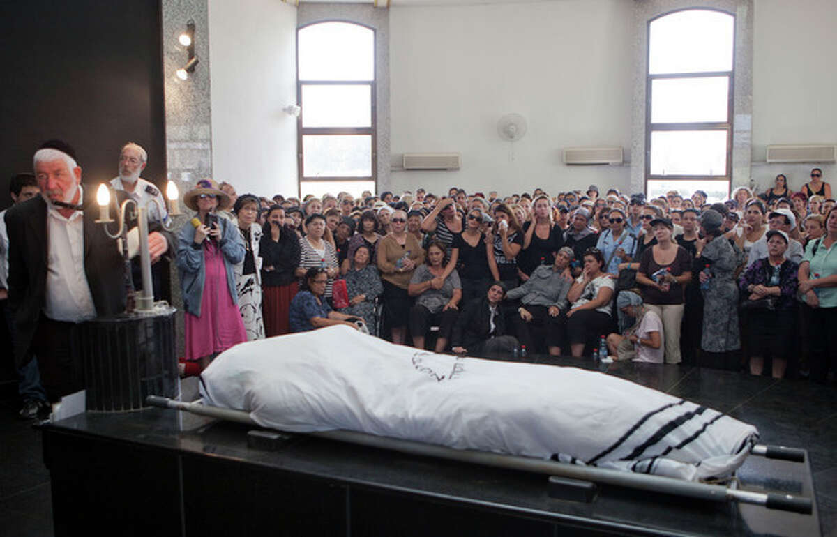 Family and friends attend the funeral of Itzik Kolengi, 28, who was killed and his wife injured in a suicide bombing in Bulgaria Wednesday in Petah Tikva, Israel, Friday, July 20, 2012. Israeli and American officials are blaming the Lebanese militant group Hezbollah for the bombing that killed five Israeli tourists, a Bulgarian bus driver and the bomber in the Black Sea resort town of Burgas, a popular destination for Israeli tourists. (AP Photo/Dan Balilty)
