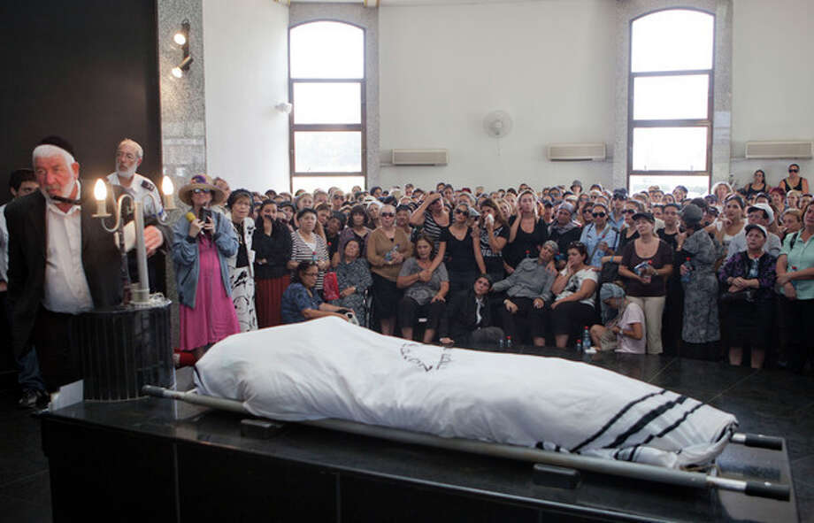 Family and friends attend the funeral of Itzik Kolengi, 28, who was killed and his wife injured in a suicide bombing in Bulgaria Wednesday in Petah Tikva, Israel, Friday, July 20, 2012. Israeli and American officials are blaming the Lebanese militant group Hezbollah for the bombing that killed five Israeli tourists, a Bulgarian bus driver and the bomber in the Black Sea resort town of Burgas, a popular destination for Israeli tourists. (AP Photo/Dan Balilty) / AP
