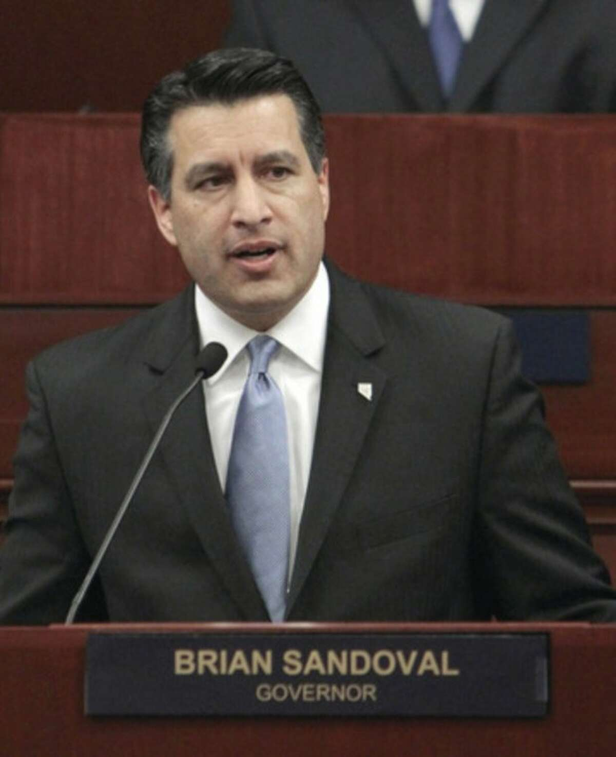 FILE - In this Jan. 24, 2011 file photo, Nevada Gov. Brian Sandoval makes his first State of the State address in Carson City, Nev. Sandoval, New Mexico Gov. Susana Martinez, and Florida Sen. Marc Rubio are popular, political newcomers who toe a safe party line in presidential battleground states. The rising GOP stars are also Hispanics, a fact the Republican Party clearly hopes to capitalize on in the upcoming national elections. (AP Photo/Rich Pedroncelli, File)