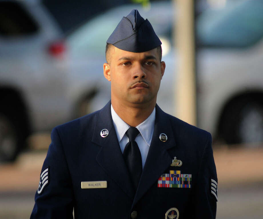 Air Force Staff Sgt. Luis Walker arrives for the fourth day of his trial at Lackland Air Force Base in San Antonio, Texas, Friday, July 20, 2012. Walker is accused of sexually assaulting 10 basic trainees, with charges ranging from rape and aggravated sexual assault to obstructing justice and violating rules of professional conduct. If convicted, he could be sentenced to life imprisonment. (AP Photo/San Antonio Express News, Billy Calzada) / San Antonio Express-News