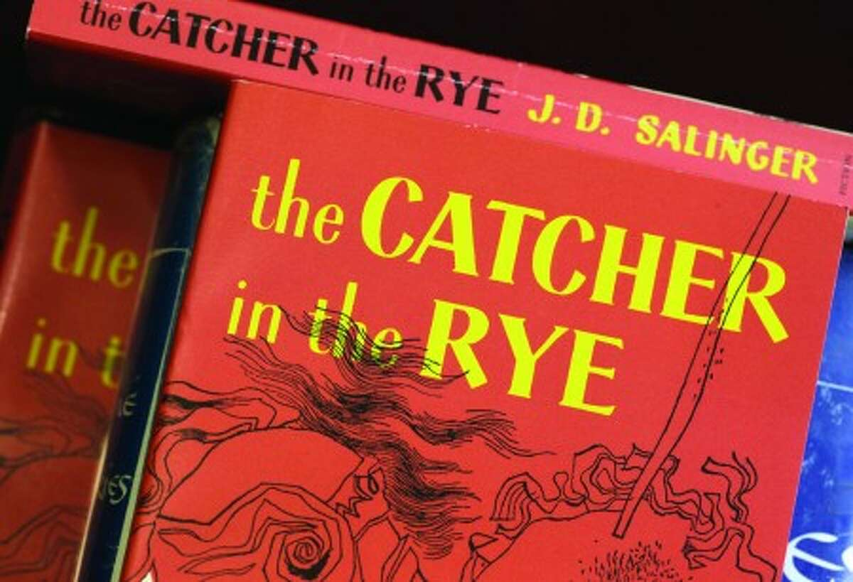 """FILE - In this Jan. 28, 2010 file photo, copies of J.D. Salinger''s classic novel """"The Catcher in the Rye"""" are seen at the Orange Public Library in Orange Village, Ohio. (AP Photo/Amy Sancetta)"""
