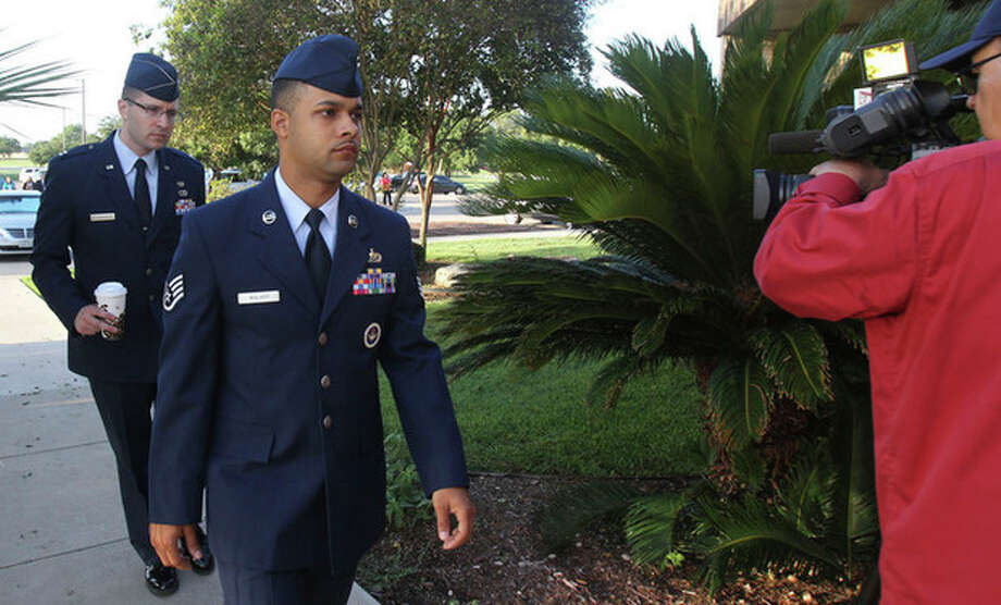 Air Force Staff Sgt. Luis Walker, left foreground, arrives for the fourth day of his trial at Lackland Air Force Base in San Antonio, Texas, Friday, July 20, 2012. Walker is accused of sexually assaulting 10 basic trainees, with charges ranging from rape and aggravated sexual assault to obstructing justice and violating rules of professional conduct. If convicted, he could be sentenced to life imprisonment. (AP Photo/San Antonio Express News, Billy Calzada) / San Antonio Express-News