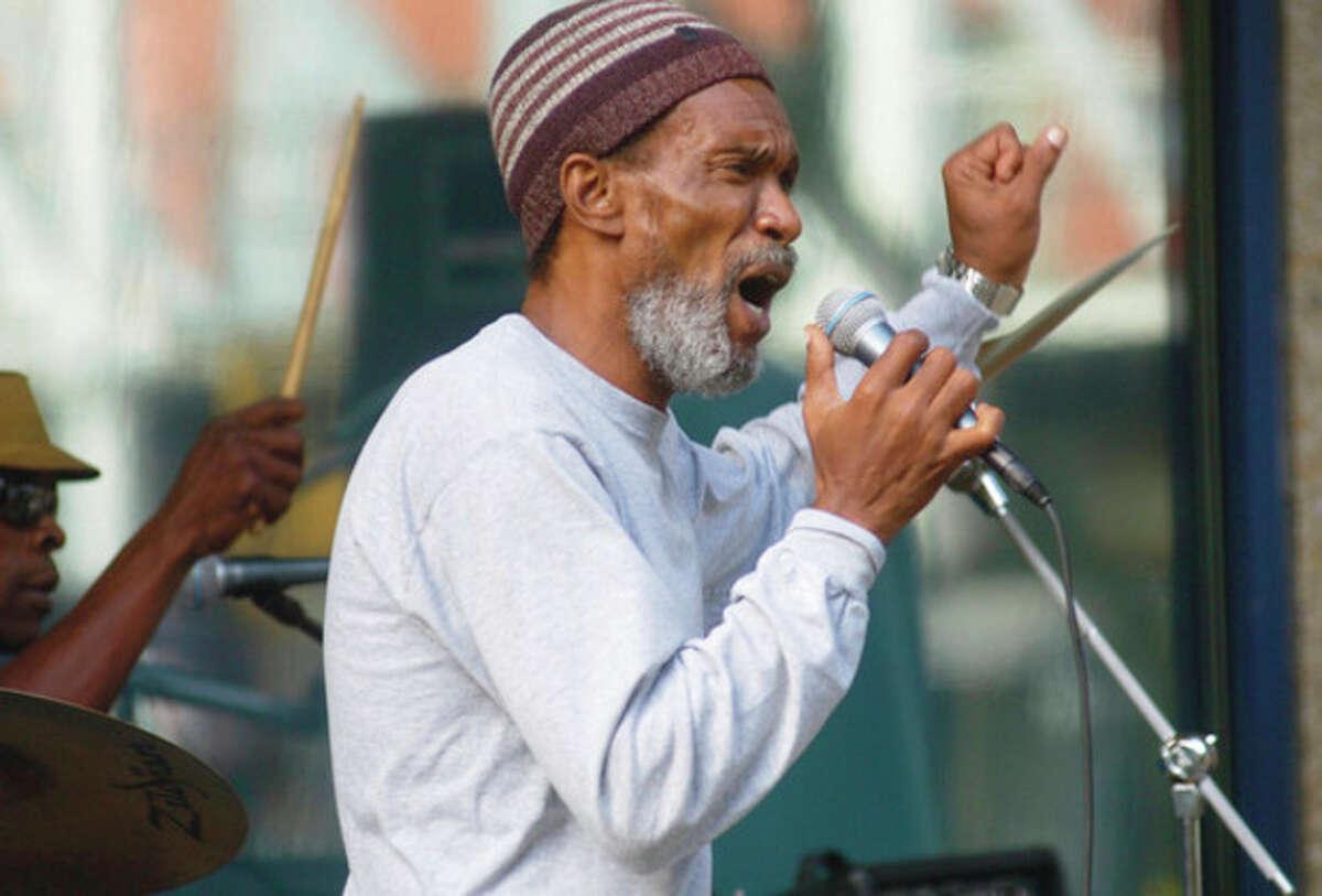 Robert Mint, lead singer of the band Reggae Culture perform duringthe third installment of the SoNo Summer Concert series Thursday on Washington St. Hour photo / Erik Trautmann