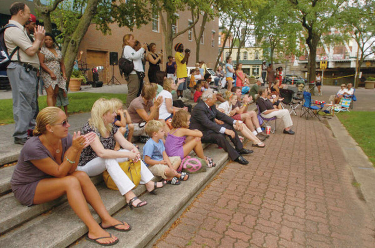 People gather to hear the sounds of Reggae Culture during the third installment of the SoNo Summer Concert series Thursday on Washington St. Hour photo / Erik Trautmann