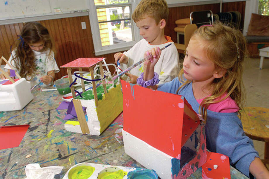 Adela Ardery, 5, and her brother Max Ardery, 6, make houses out of found objects during the Rowayton Arts Center Summer Art Sessions for Kids Wednesday. The last sessions for the summer are held next week on Tuesday, Wednesday and Thursday. Space is still vailable for children 6-11. / (C)2011, The Hour Newspapers, all rights reserved