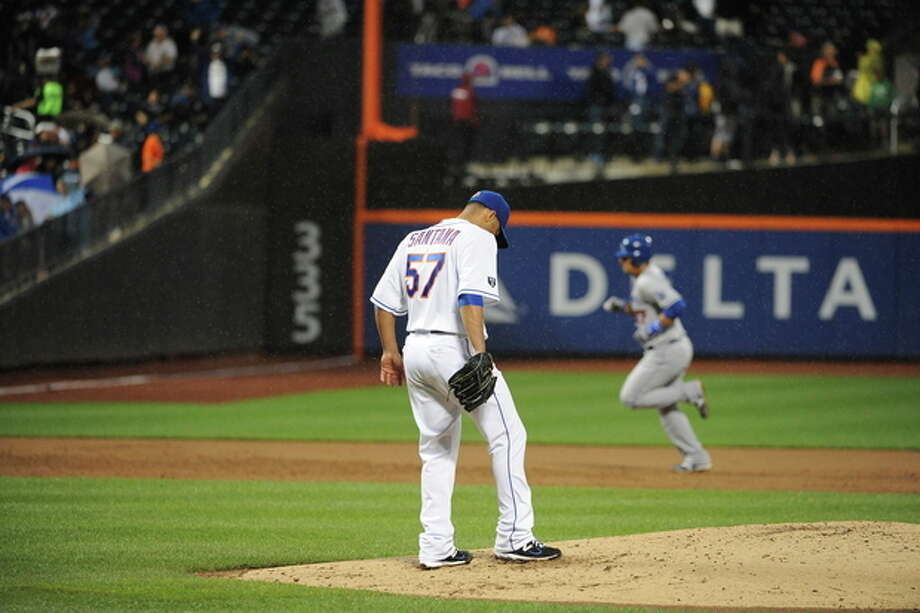 New York Mets starting pitcher Johan Santana (57) reacts on the mound as Los Angeles Dodgers' Luis Cruz rounds the bases after hitting a two-run home run in the third inning of a baseball game on Friday, July 20, 2012, at Citi Field in New York. (AP Photo/Kathy Kmonicek) / FR170189 AP