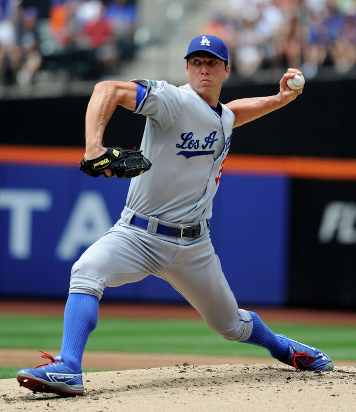 Los Angeles Dodgers starting pitcher Chris Capuano throws against the New York Mets during the second inning of a baseball game on Saturday, July 21, 2012, at Citi Field in New York. (AP Photo/Kathy Kmonicek)