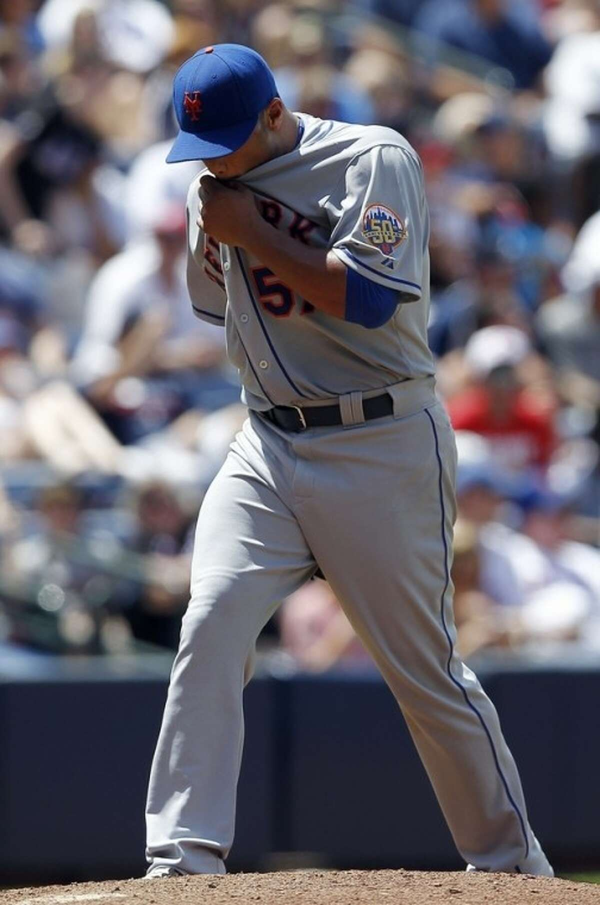 New York Mets starting pitcher Johan Santana paces on the mound after allowing a run in the fifth inning of a baseball game against the Atlanta Braves, Sunday, July 15, 2012, in Atlanta. (AP Photo/John Bazemore)