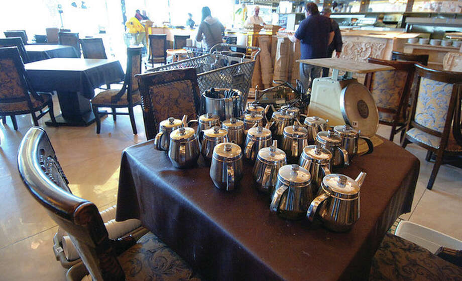 Hour Photo/ Alex von Kleydorff. Teapots sit on a table unsold after the auction at the closed Jani Restaurant in the WalMart shopping center / 2011 The Hour Newspapers