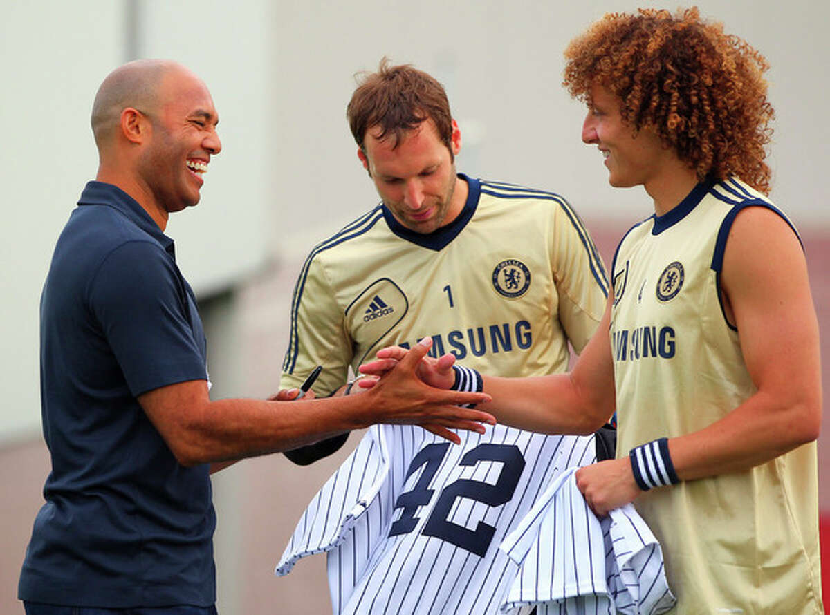 New York Yankees pitcher Mariano Rivera, left, greets Chelsea FC's Petr Cech (1) and David Luiz, right, after their soccer training session in East Rutherford, N.J., Saturday, July. 21, 2012. Chelsea will face Paris Saint-Germain in a friendly soccer game at Yankee Stadium on Sunday. (AP Photo/Rich Schultz)