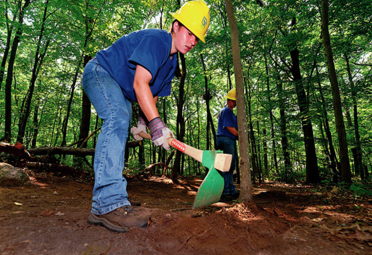 Patty and Mary Sciglimpaglia help build the trail.