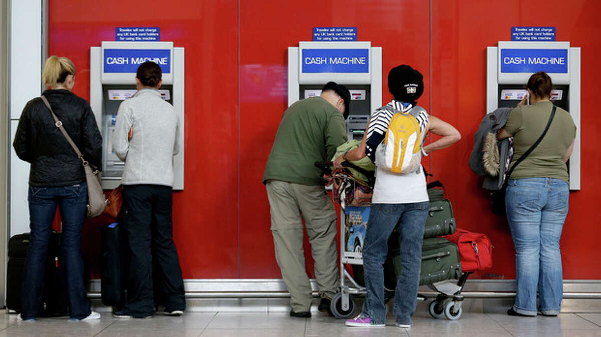 AP Photo/Charlie Riedel Travelers withdraw cash from ATM machines at Heathrow Airport Wednesday, July 18, as London prepares for the 2012 Summer Olympics. Tourists be warned: The Olympics crush has begun in London -- and so has the scramble for cold, hard cash in the pricey British capital. Lines are getting longer at ATMs, visitors are in sticker shock over British prices and some befuddled tourists are wondering what currency to use. Stores in the Olympic Park only accept certain credit cards and a British financial authority is even recommending that tourists make sure to bring British pounds with them.