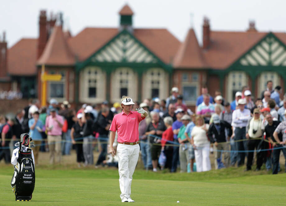 Brandt Snedeker of the United States prepares to play a shot on the second fairway at Royal Lytham & St Annes golf club during the third round of the British Open Golf Championship, Lytham St Annes, England, Saturday, July 21, 2012. (AP Photo/Peter Morrison) / AP