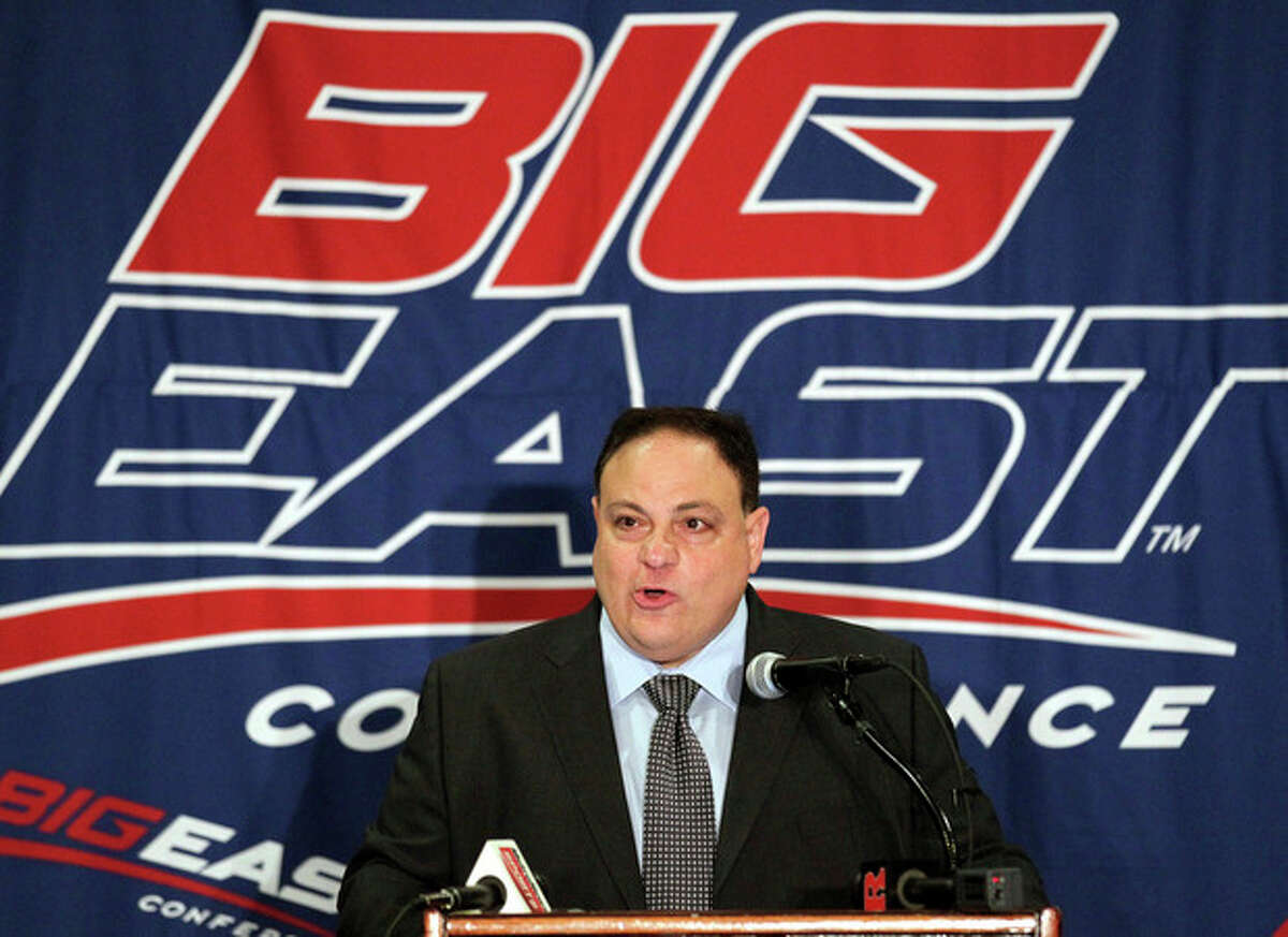 FILE - This Aug. 2, 2011 file photo shows Big East commissioner John Marinatto speaking to reporters during Big East football media day, in Newport, R.I. The Big East presidents voted Monday night, Oct. 17, 2011, to double the exit fee for football members to $10 million, a person with knowledge of the decision told The Associated Press. The person spoke on condition of anonymity because the conference did not plan to make any announcements. Commissioner Marinatto has a teleconference scheduled with reporters for Tuesday. (AP Photo/Stew Milne, File)