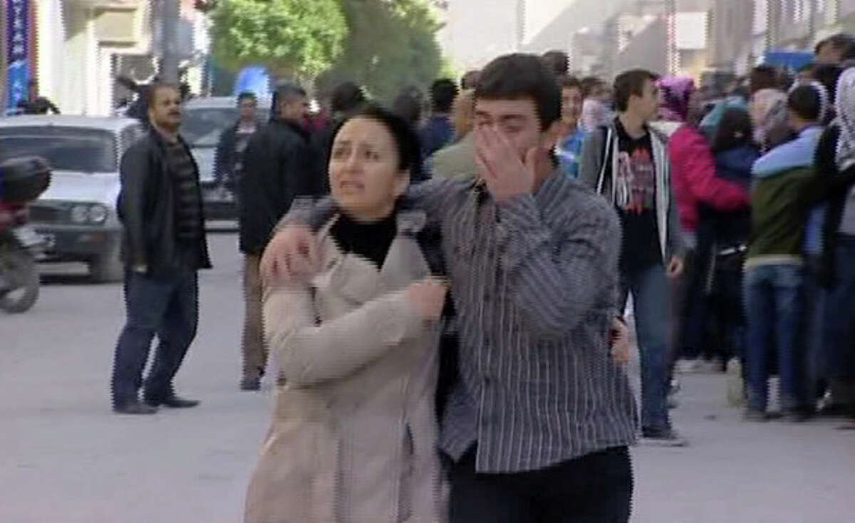Residents take to the streets after a earthquake in Van eastern Turkey in this image taken from Sunday Oct. 23, 2011. _ A powerful earthquake struck eastern Turkey Sunday, collapsing at least two buildings in the center of eastern city of Van, the mayor said. (AP Photo/Anatolian TV. via APTN) TURKEY OUT TV OUT