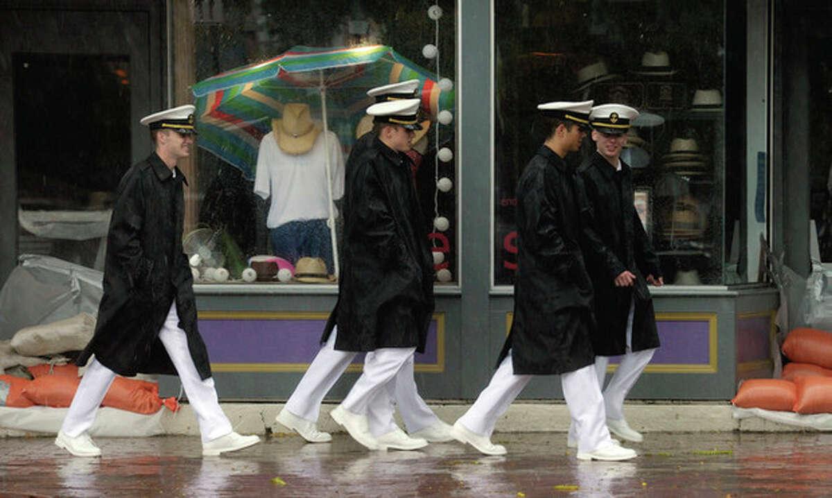Naval Academy midshipmen walk in downtown Annapolis, Md., during Hurricane Irene, Saturday, Aug. 27, 2011. (AP Photo/Susan Walsh)
