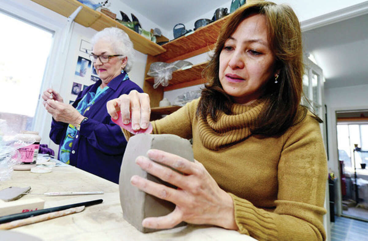 Pam Meily and Ruth Ferraro of Stamford work on their ceramic projects at Lakeside Pottery in Stamford.