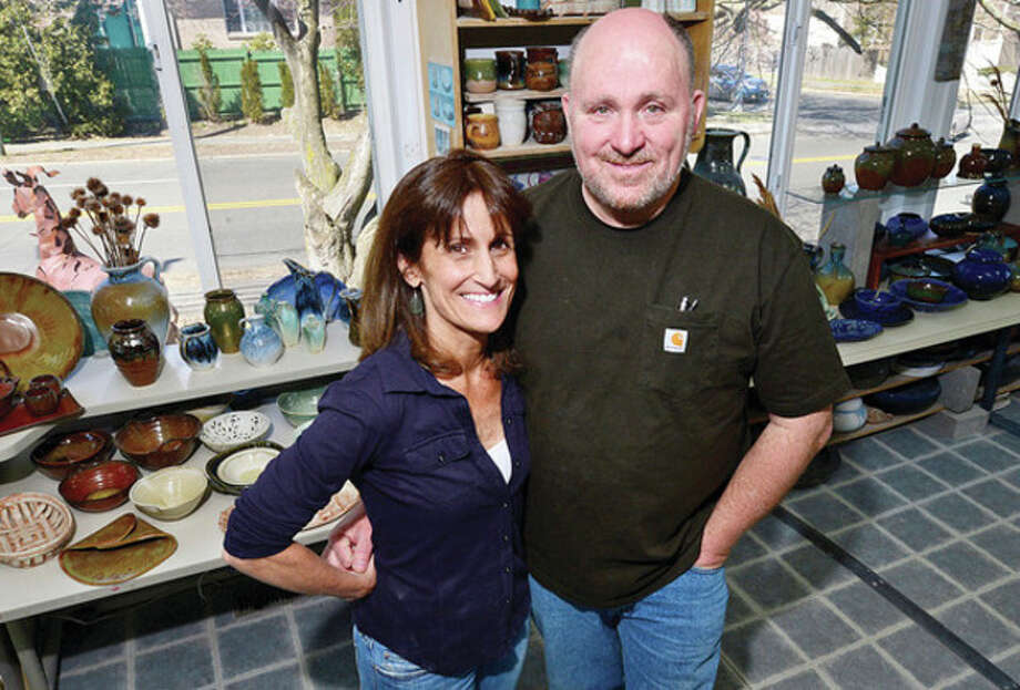 Hour photos / Erik TrautmannLakeside Pottery, which offers pottery and ceramic classes, is owned and managed by the husband and wife team of Patty Storms and Morty Bacha, above. It is a ceramic art and craft educational resource for the community, focusing on clay art which also takes on custom-made commission ceramic art and ceramic repair and restoration projects that require unique attention to details and perfection. At top is an example of a face molded from clay. / (C)2013, The Hour Newspapers, all rights reserved