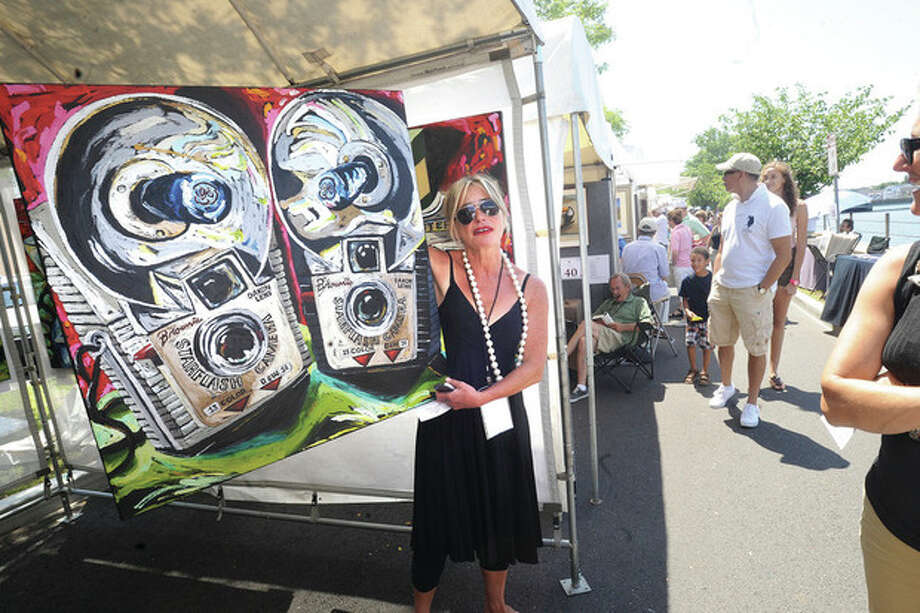 Hour photo/Matthew VinciArtist Julia Gilmore, with her painting called Brownie Cameras, was one of many who displayed their work at the Westport Fine Arts Festival on Sunday.