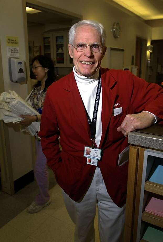 Dave Bell has logged 15,000 hours as a volunteer at the Stamford Hospital Emergency Department and was recently honored for his efforts. Hour phototo / Erik Trautmann