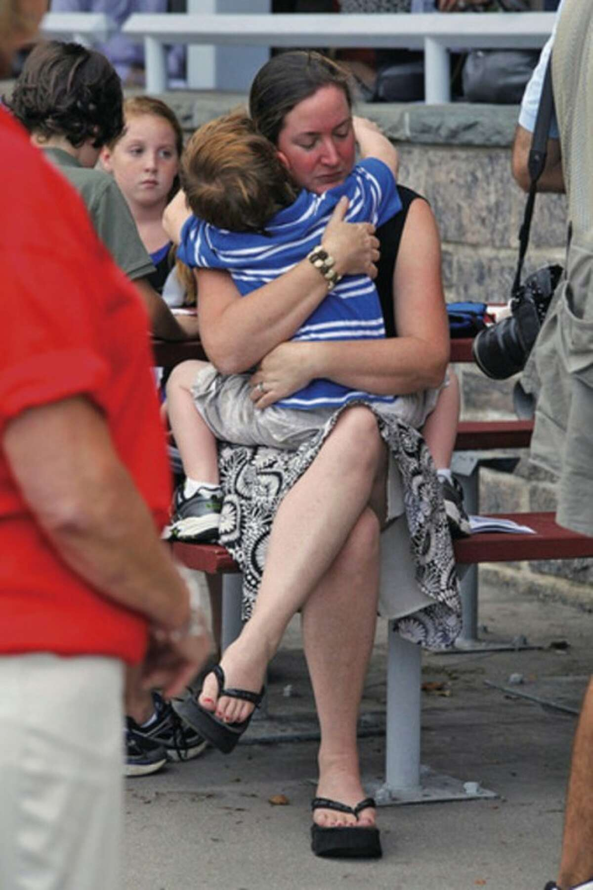 A woman hugs her son during the Connecticut Remembers Steptember 11th Memorial Service held at Sherwood Island State Park Thursday evening.