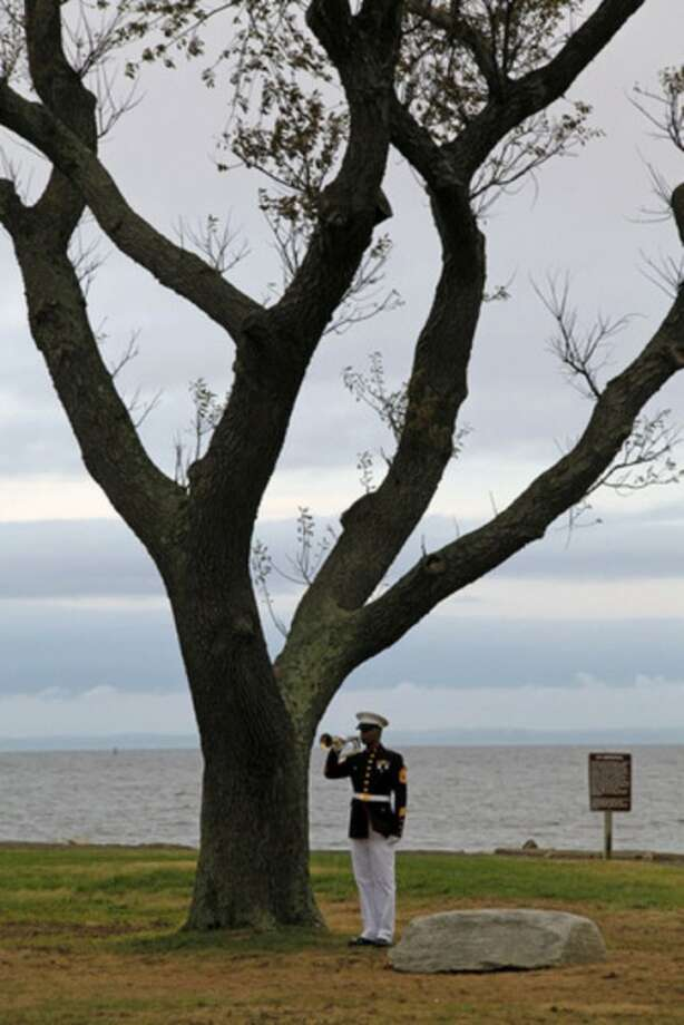 Taps is played during the Connecticut Remembers Steptember 11th Memorial Service held at Sherwood Island State Park Thursday evening.