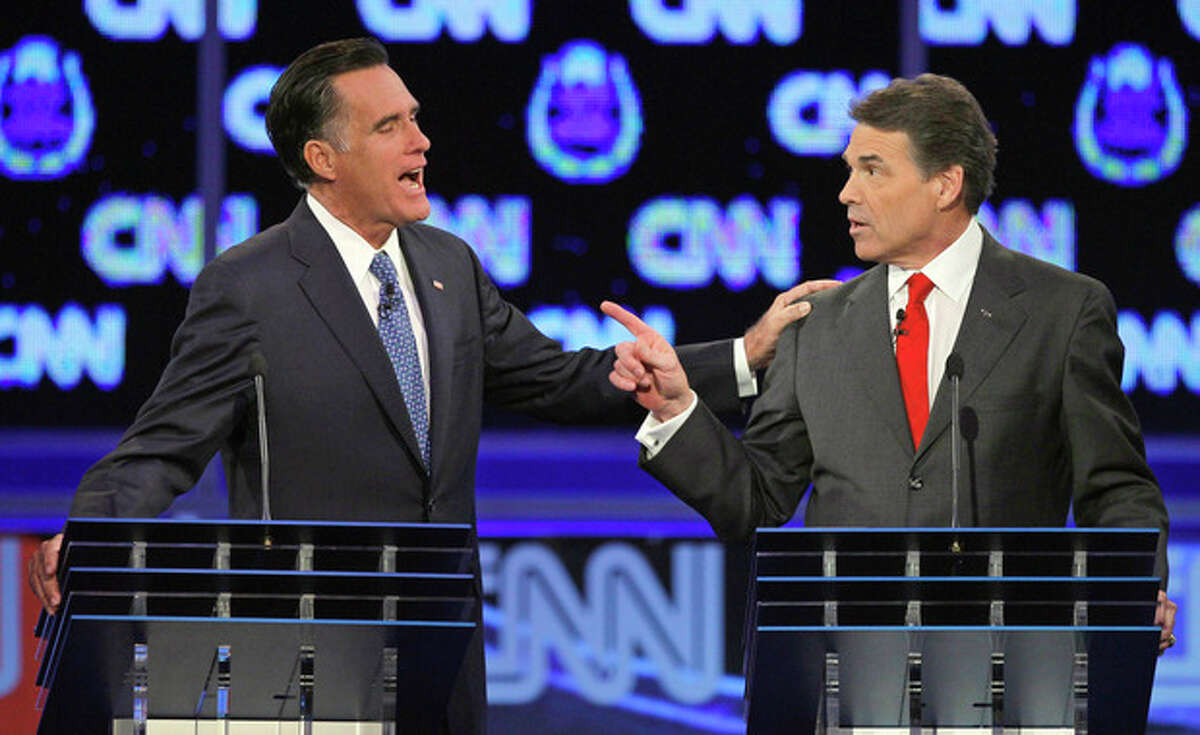 FILE - In this Oct. 18, 2011 file photo, Republican presidential candidates, former Massachusetts Gov. Mitt Romney, left, and Texas Gov. Rick Perry, speak during a Republican presidential debate in Las Vegas. Perry won't commit to upcoming GOP presidential debates after a couple of recent rocky performances pulled him down in national polls. Seeking to reintroduce himself to the nation on his own terms, he's returning to the play-it-safe strategy he successfully employed in running for governor of Texas. His decision could cause other Republicans to bow out of some of the dozen-plus forums and debates between now and the Iowa caucuses on Jan. 3. (AP Photo/Chris Carlson, File)