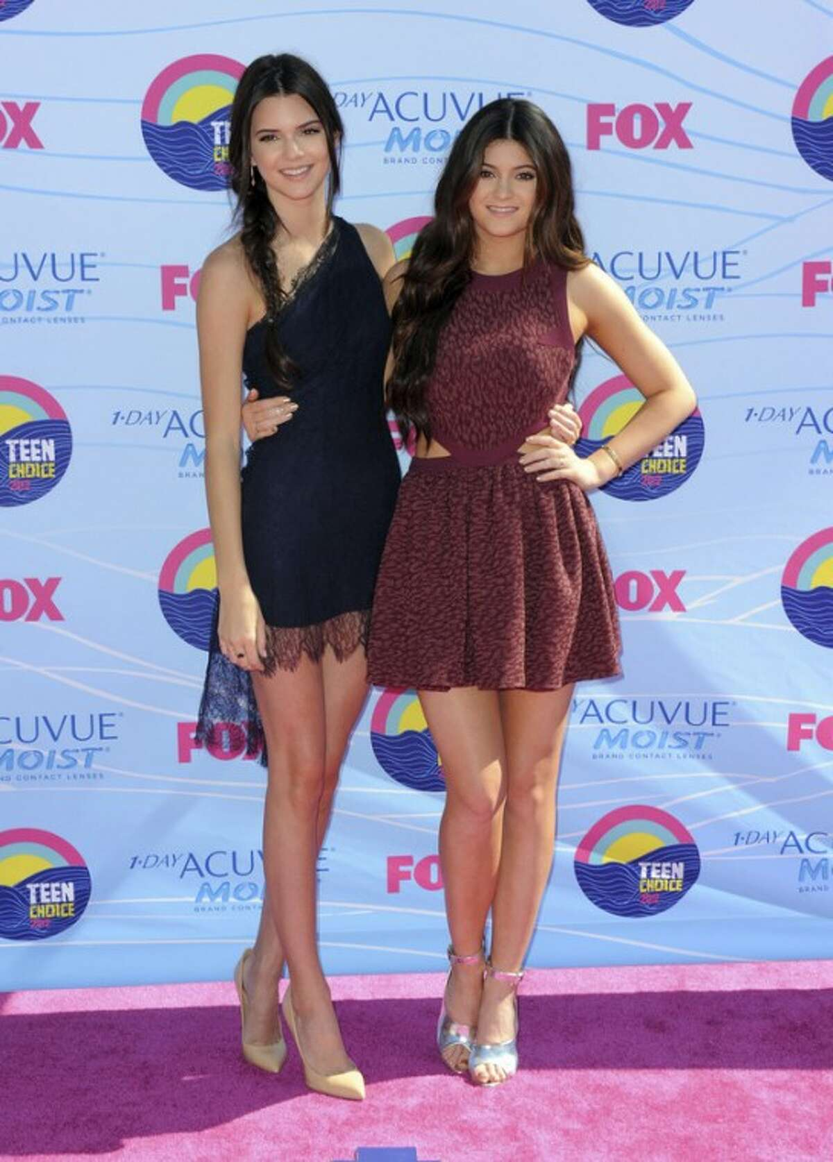 Kendall Jenner, left, and Kylie Jenner arrive at the Teen Choice Awards on Sunday, July 22, 2012, in Universal City, Calif. (Photo by Jordan Strauss/Invision/AP)