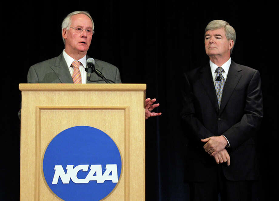 Ed Ray, left, NCAA Executive Committee chair and Oregon State University president, answers questiong about the penalties against Penn State as NCAA President Mark Emmert, looks on during a news conference in Indianapolis, Monday, July 23, 2012. The NCAA has slammed Penn State with an unprecedented series of penalties, including a $60 million fine and the loss of all coach Joe Paterno's victories from 1998-2011, in the wake of the Jerry Sandusky child sex abuse scandal.  (AP Photo/Michael Conroy) / AP