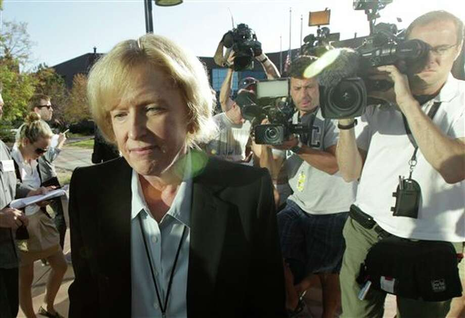 Carol Chambers, Arapahoe County District Attorney, arrives at the county courthouse, Monday, July 23, 2012, in Centennial, Colo., the day of the first court appearance of James E. Holmes, who is being held on suspicion of first-degree murder, and who could also face additional counts of aggravated assault and weapons violations, stemming from a mass shooting last Friday in a movie theater in Aurora, Colo., that killed 12 and injured dozens of others. (AP Photo/Ted S. Warren) / AP2012