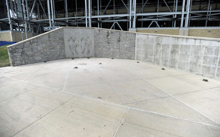 The area where Joe Paterno's statue and other items were displayed is empty outside Beaver Stadium, Sunday, July 22, 2012, in State College, Pa. The famed statue of the late Paterno, former Penn State college football coach, was taken down from outside the university's football stadium Sunday, eliminating a key piece of the iconography surrounding the once-sainted football coach accused of burying child sex abuse allegations against retired assistant Jerry Sandusky . (AP Photo/Centre Daily Times, Christopher Weddle) / Centre Daily Times