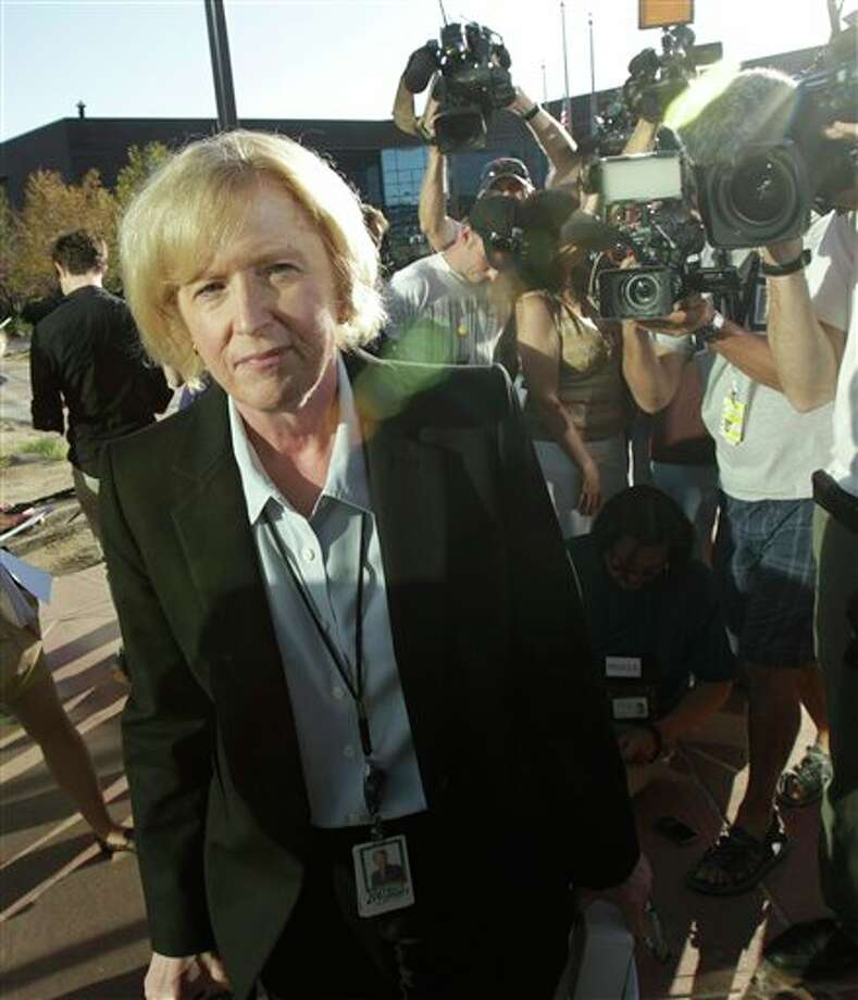 Carol Chambers, Arapahoe County District Attorney, arrives at the county courthouse, Monday, July 23, 2012, in Centennial, Colo., the day of the first court appearance of James E. Holmes, who is being held on suspicion of first-degree murder, and who could also face additional counts of aggravated assault and weapons violations, stemming from a mass shooting last Friday in a movie theater in Aurora, Colo., that killed 12 and injured dozens of others. (AP Photo/Ted S. Warren) / AP