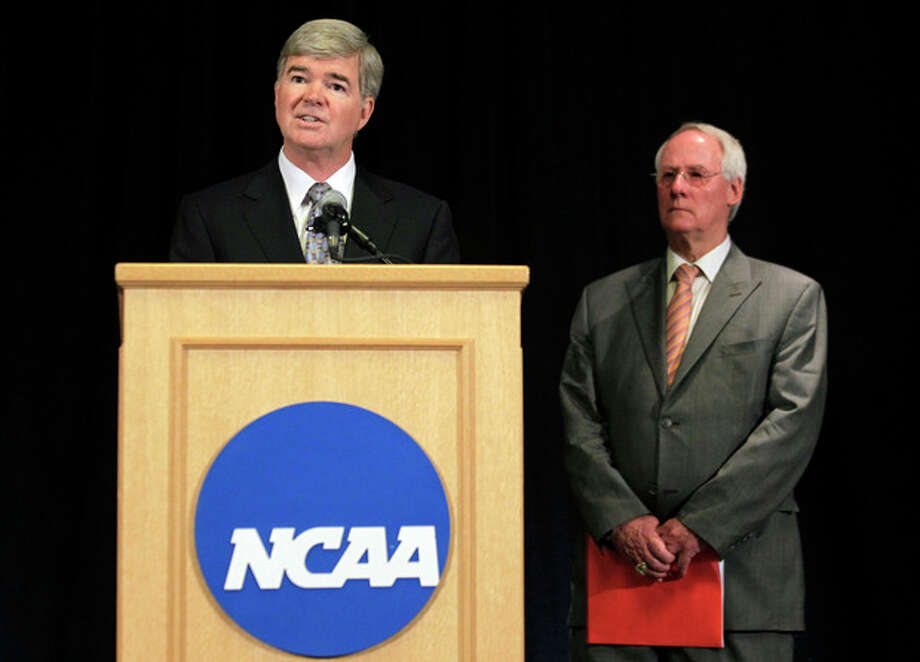 NCAA President Mark Emmert, left, announces penalties against Penn State as Ed Ray, NCAA Executive Committee chair and Oregon State University president, looks on at right, during a news conference in Indianapolis, Monday, July 23, 2012. The NCAA has slammed Penn State with an unprecedented series of penalties, including a $60 million fine and the loss of all coach Joe Paterno's victories from 1998-2011, in the wake of the Jerry Sandusky child sex abuse scandal. (AP Photo/Michael Conroy) / AP