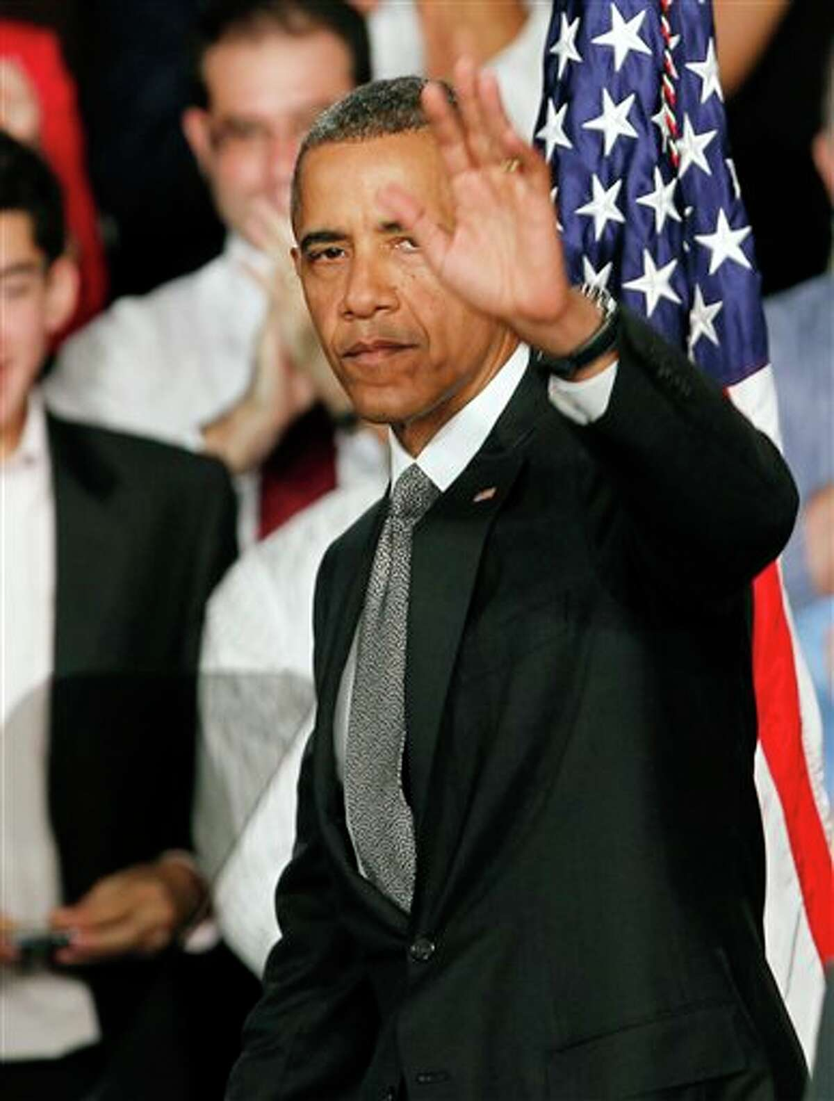 """President Barack Obama waves to supporters after talking about the events in Aurora, Colo., during a campaign stop in Fort Myers, Fla., Friday, July 19, 2012. Obama said the tragic movie theater shooting in Colorado that left 12 people dead is a reminder that life is fragile. He says the event """"reminds us of all the ways that we are united as one American family."""""""