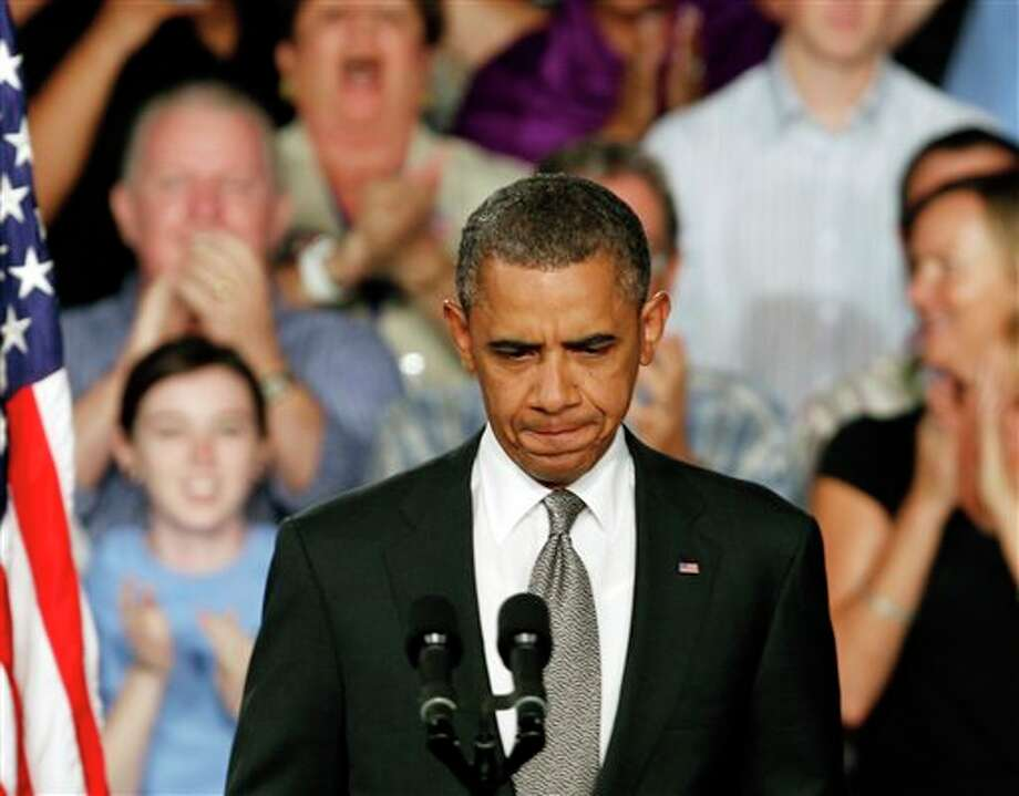"""President Barack Obama prepares to address supporters during a campaign stop in Fort Myers, Fla., Friday, July 19, 2012. Obama said the tragic movie theater shooting in Colorado that left 12 people dead is a reminder that life is fragile. He says the event """"reminds us of all the ways that we are united as one American family."""" / AP"""