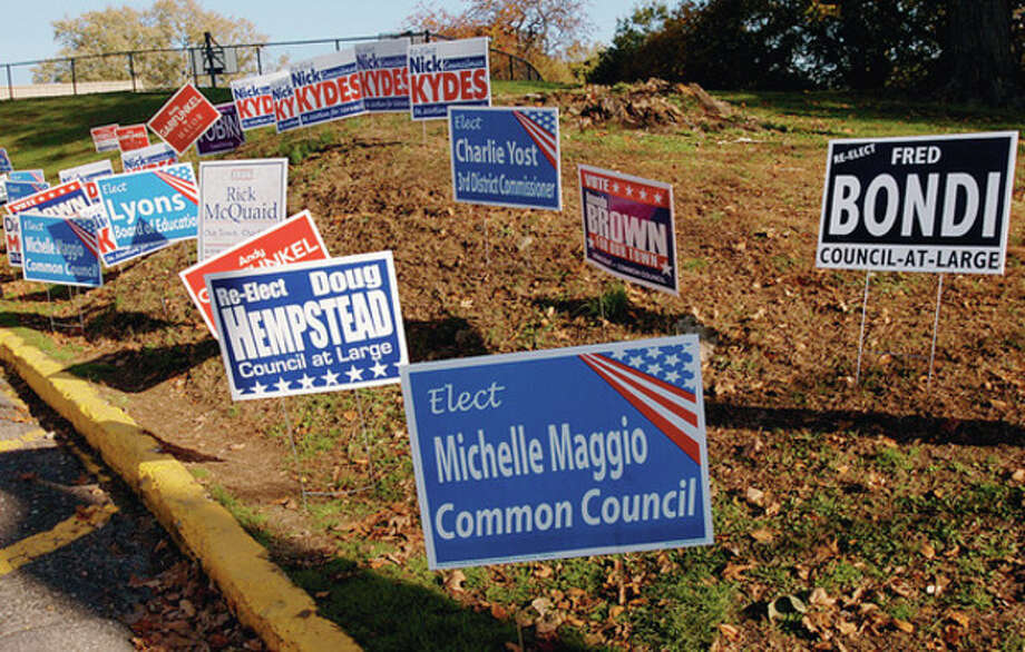 Hour photo / Erik Trautmann Election signs planted at Marvin Elementary School Tuesday.