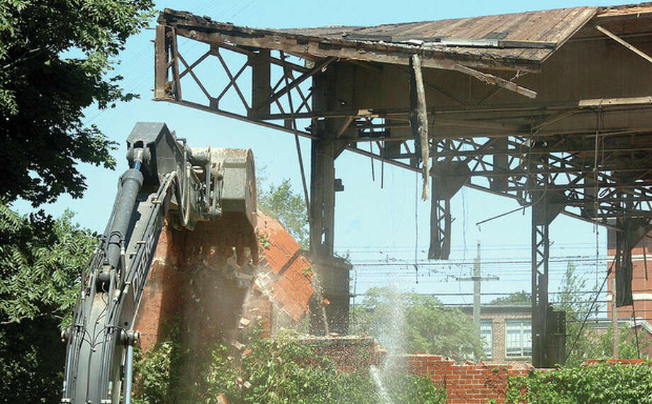 Hour Photo/ Alex von Kleydorff. The Norwalk Company building comes down on Monday. / 2012 The Hour Newspapers