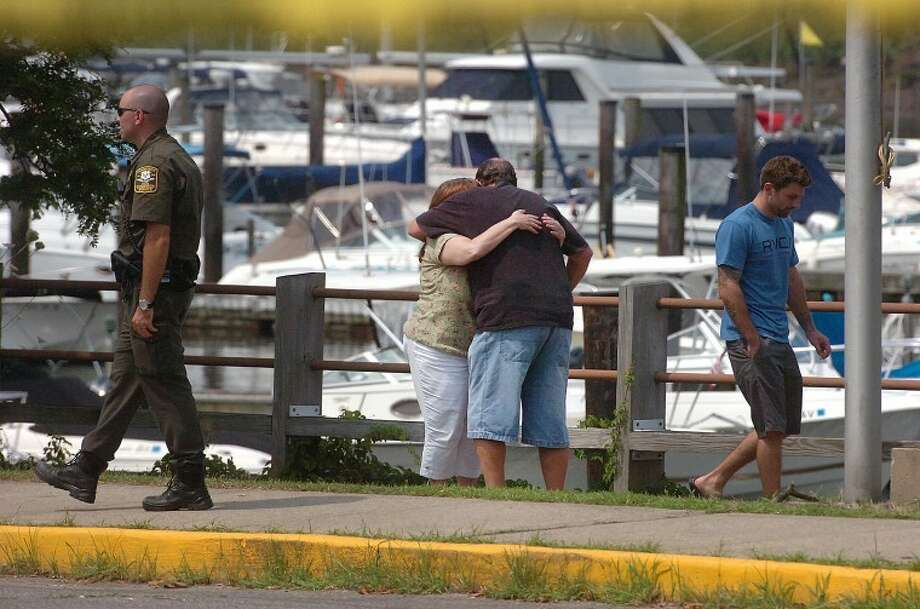 Hour Photo/ Alex von Kleydorff. Family and freinds gather Monday morning at Stamfords Czescik Municipal Marina to wait for information on a search for the missing NY firefighter, lost after his boat crashed Sunday night in Stamford harbor