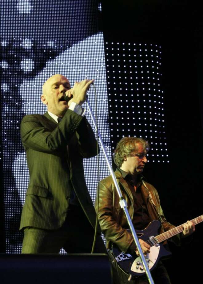 AP photo / Matthias Rietschel In this 2008 file photo, U.S. rock band R.E.M. with singer Michael Stipe, left, and guitarist Peter Buck, right, perform at an open air concert in Dresden, eastern Germany.