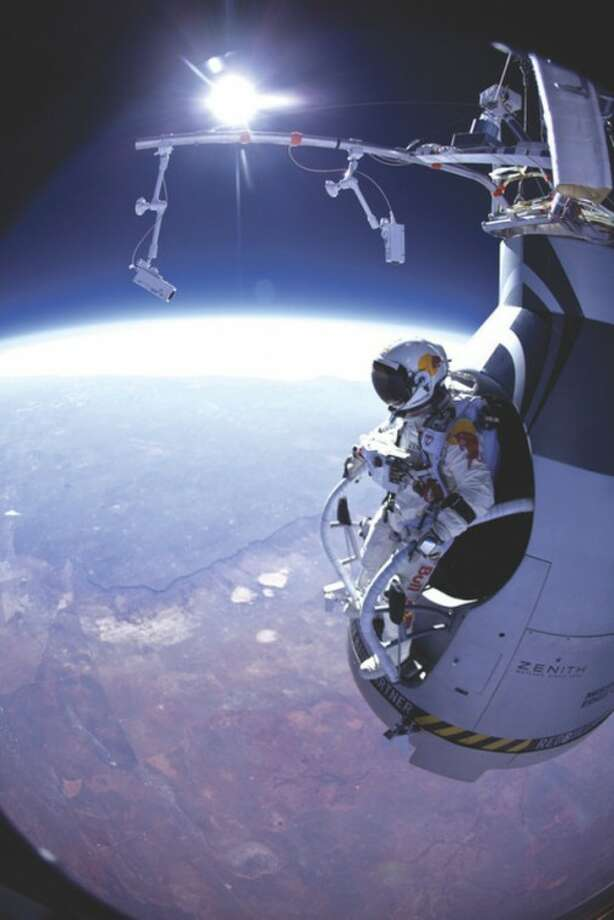 """FILE - In this Thursday, March 15, 2012 photo provided by Red Bull Stratos, Felix Baumgartner prepares to jump during the first manned test flight for Red Bull Stratos over Roswell, N.M. On Wednesday, July 25, 2012, the 43-year-old Austrian plunged to Earth from an altitude of more than 18 miles landing safely near Roswell, N.M. It's was second stratospheric leap for """"Fearless Felix."""" He's aiming for a record-breaking jump from 125,000 feet, or 23 miles, in another month. He hopes to go supersonic, breaking the speed of sound with just his body. (AP Photo/Red Bull Stratos, Jay Nemeth)"""
