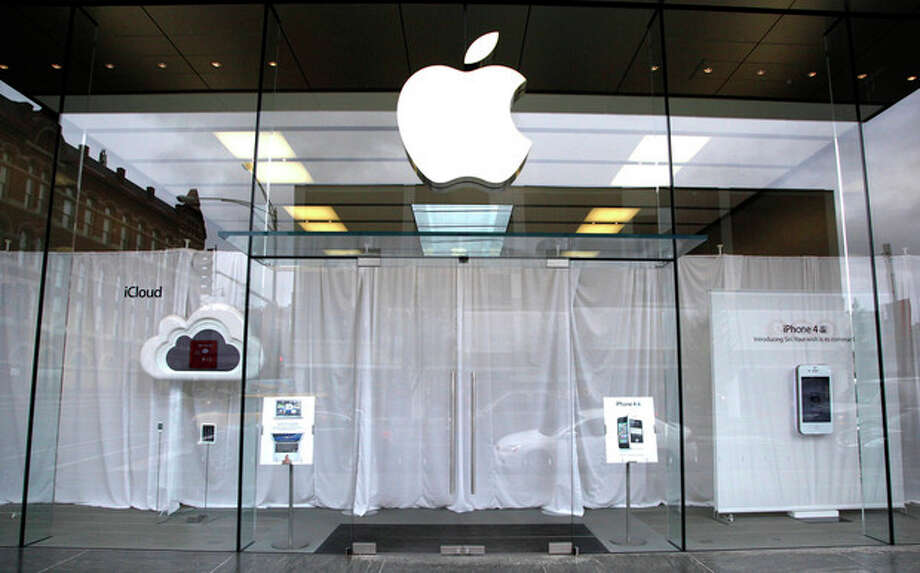 White curtains hang as employees inside the Lincoln Park Apple store in Chicago, gather to watch a video feed from the California memorial service for founder Steve Jobs Wednesday, Oct. 19, 2011. (AP Photo/Charles Rex Arbogast) / AP